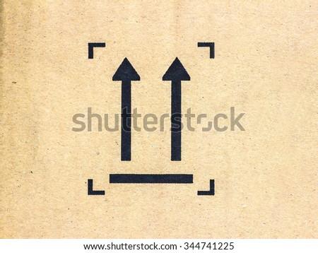 grunge color fragile symbol on old cardboard. - stock photo