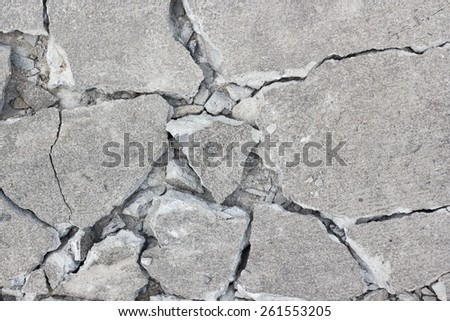 Grunge concrete cement wall with crack in industrial building, great for your design and texture background - stock photo