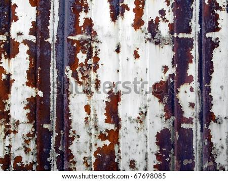 Grunge corrugated rusty metal surface. - stock photo