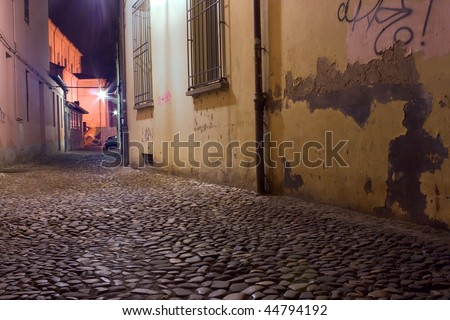 grunge dark alley at night, slums of the city, squalid dirty corner of street in the decadent old town