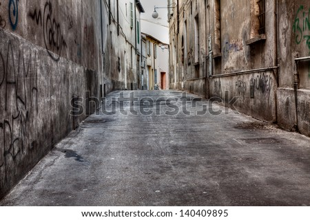 grunge dark alley - dirty city street - italian distressed old town - urban decay - stock photo