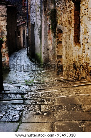 grunge dark alley with staircase at night in the old tuscan village - stock photo
