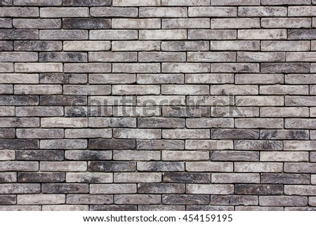 Grunge dirty gray black brick wall background. - stock photo