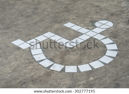 Grunge disabled parking sign - stock photo