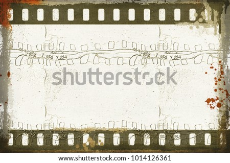 Grunge dripping film strip frame in sepia tones.