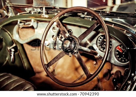 grunge effect classic car steering wheel and dash - stock photo