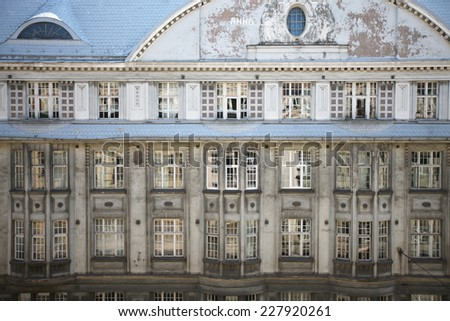 Grunge facade of historic residential building - stock photo