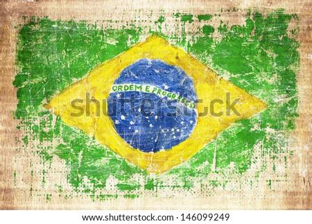 Grunge flag of Brazil on wooden texture - stock photo