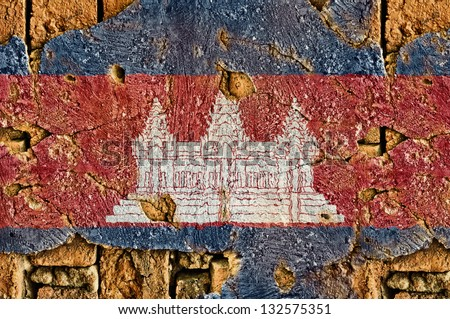 Grunge flag of cambodia on old wall background.