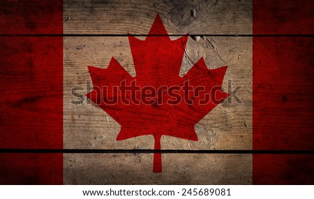 grunge flag of Canada on the wood - stock photo