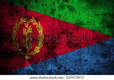grunge flag of Eritrea with capital in Asmara - stock photo