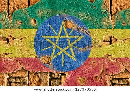 Grunge flag of Ethiopia on old wall background. - stock photo