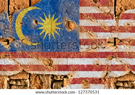Grunge flag of Malaysia on old wall background.