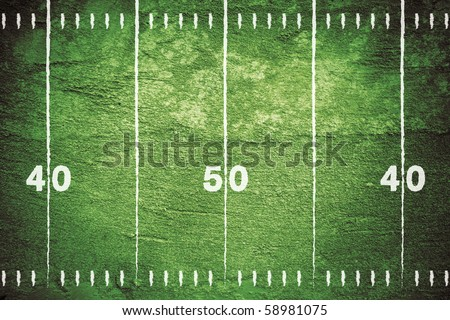 Grunge football field with close up of midfield and white chalk drawn lines. - stock photo