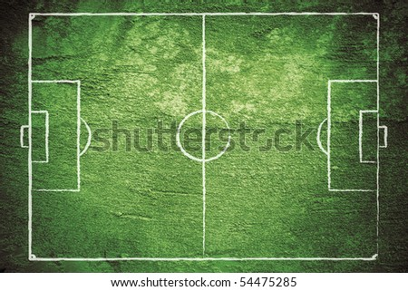 Grunge football (soccer) field with chalk drawn lines. - stock photo