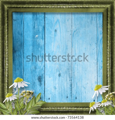 Grunge frame with bunch of flower on the wooden background - stock photo