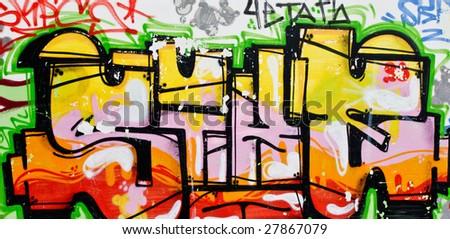 Grunge graffiti on weathered wall - stock photo