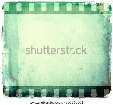 Grunge green film strip frame - stock photo