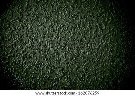 Grunge green grained wall background or texture
