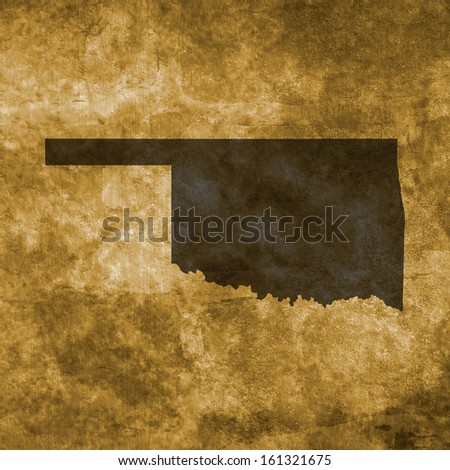 Grunge illustration with the map of Oklahoma - stock photo