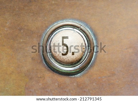 Grunge image of a button from the control area - 5 - stock photo