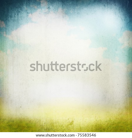 Grunge image of a field and sky with clouds