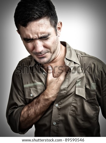 Grunge image of a man having a chest pain or heart attack - stock photo