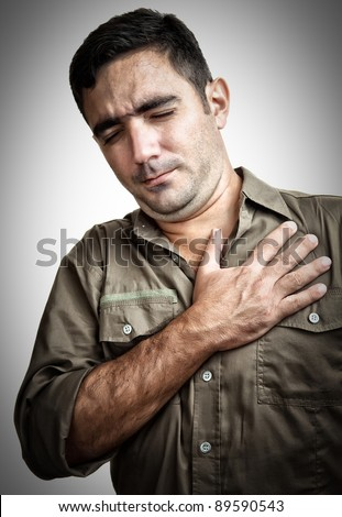 Grunge image of a man with chest pain or having a heart attack - stock photo