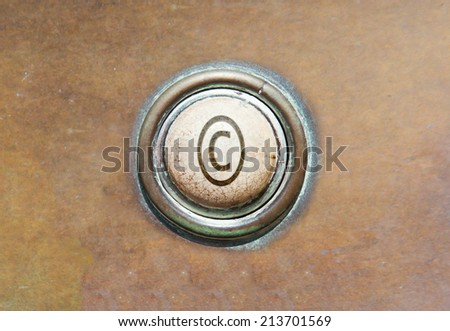 Grunge image of an old button - copyright - stock photo