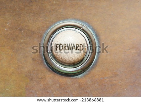 Grunge image of an old button - forward - stock photo