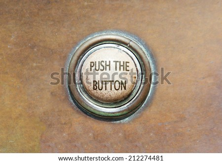 Grunge image of an old button - push the button - stock photo