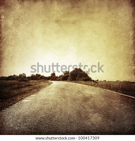 Grunge image of country road. - stock photo
