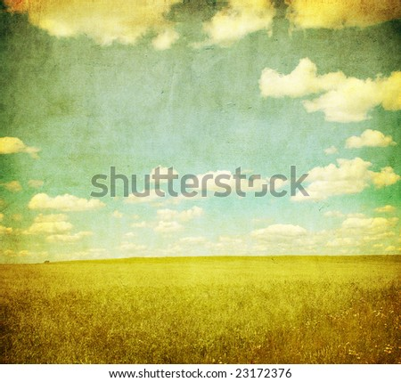 grunge image of green field and blue sky - stock photo