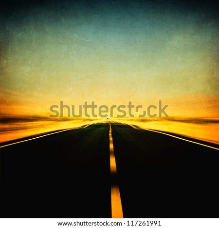 grunge image of highway and blue sky in motion blur - stock photo