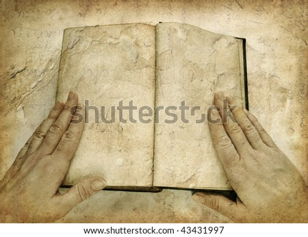 Grunge image of open book with blank pages, with woman hands - stock photo