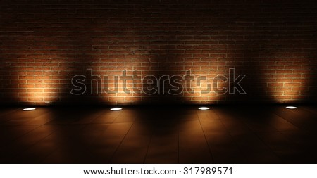 grunge interior room with brickwall lighted with spots. - stock photo