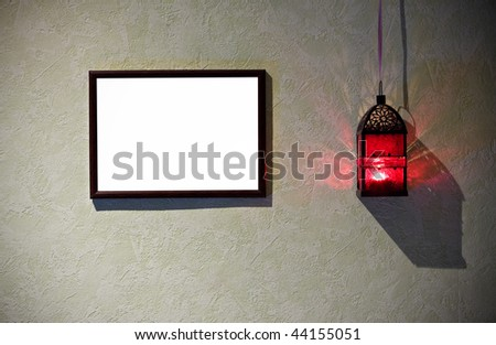 Grunge interior with frame and burning latern - stock photo