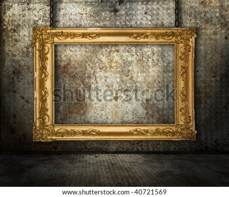 Grunge interior with gold frame - stock photo