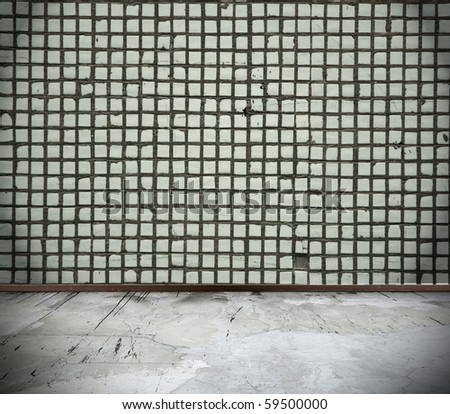 grunge interior with wall made of tile - stock photo