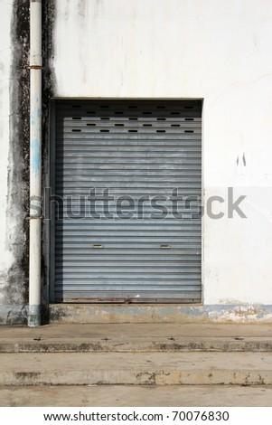 grunge iron door with sewer - stock photo