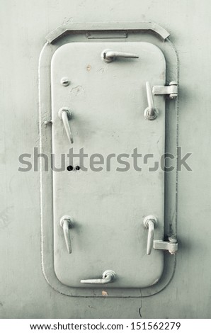 Grunge iron ship door - stock photo