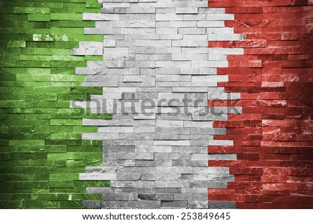 Grunge Italian Flag painted on the wall - stock photo