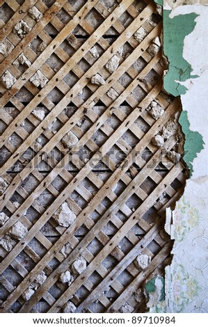 Grunge lath and plaster background on old destroyed wall - stock photo