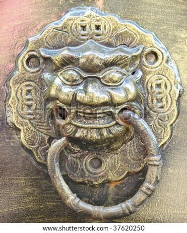 Grunge, Lion's head door knocker - stock photo