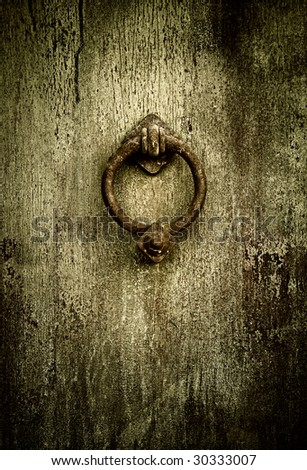 Grunge medieval background - rusty antique door knocker - stock photo