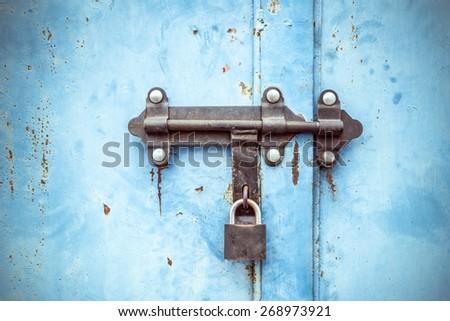 Grunge metal door locked texture. - stock photo