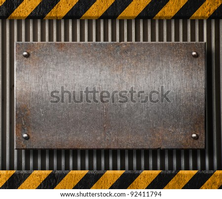 Grunge metal plate with black and yellow stripes - stock photo