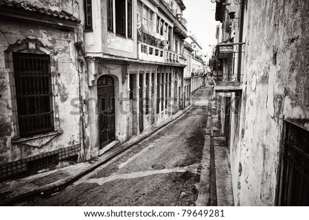 Grunge monochromatic image of a decaying buildings in Old Havana - stock photo