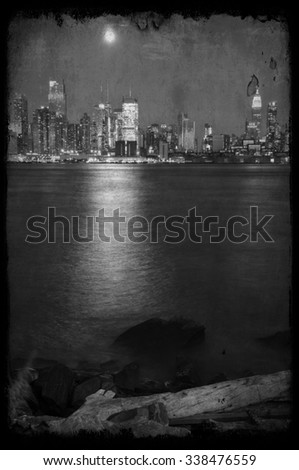 grunge new york cityscape capture at night over hudson - stock photo