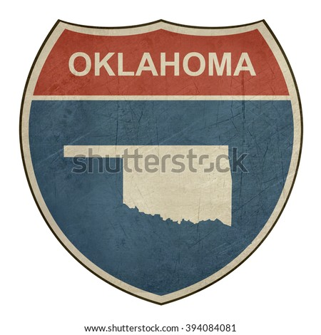 Grunge Oklahoma interstate highway road shield isolated on a white background. - stock photo